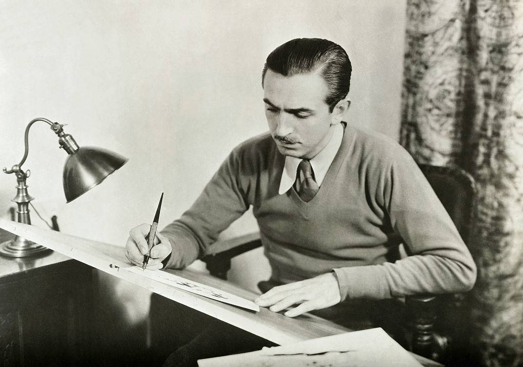 walt disney at his drawing board