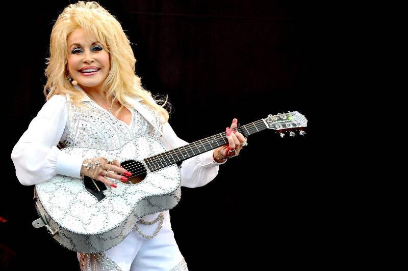 Dolly Parton performs onstage in 2014.
