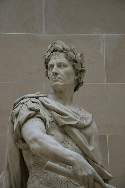 A statue of Julius Caesar by Nicolas Coustou shows him wearing a crown of laurels.