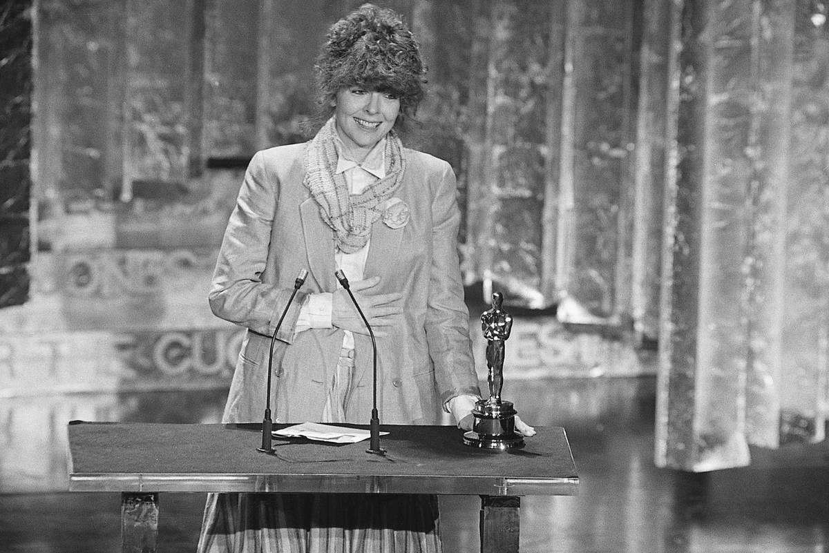 Diane Keaton accepts an Academy Award onstage in 1978.