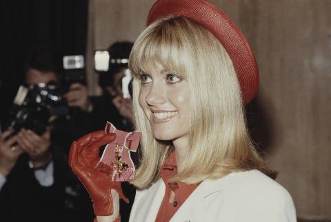 Olivia Newton-John receives an OBE at Buckingham Palace, 1979.