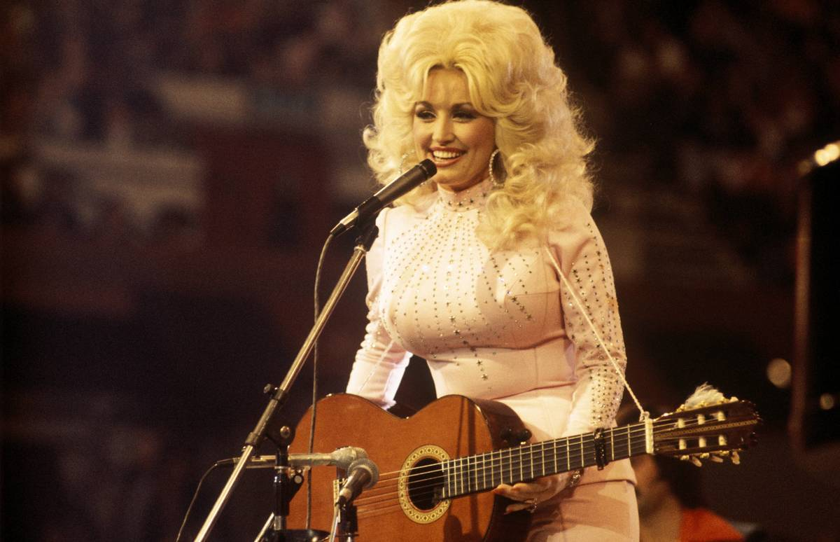 Dolly Parton performs onstage in the 1970s.