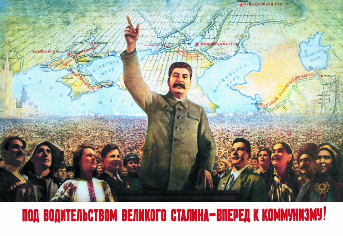 In 1900, a poster of Joseph Stalin shows him standing above Russian citizens and pointing upward.