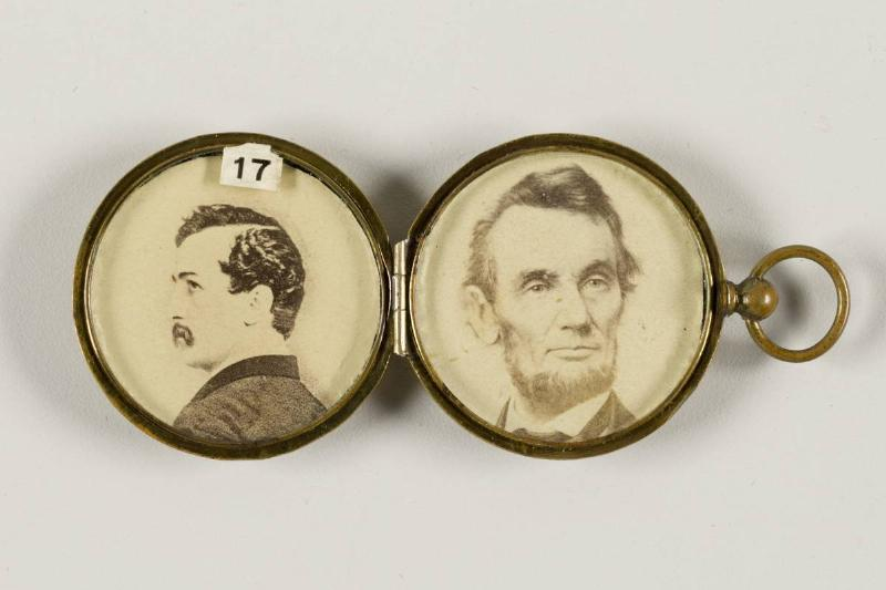 Locket holding photos of John Wilkes Booth and Abraham Lincoln