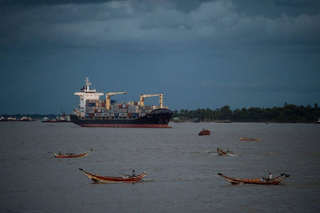 a container ship is anchored along the Yangon river