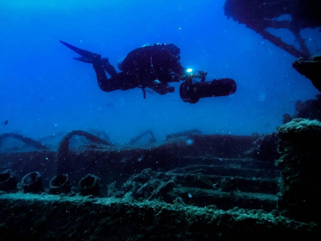a scuba diver near a shipwreck