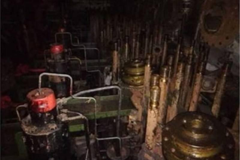 inside the ghost ship with rust and old parts