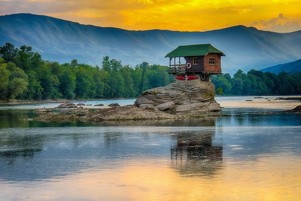 The Drina River House appears on a rock in the middle fo the Drina River.