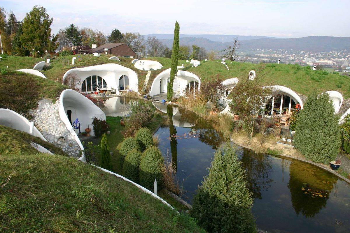 The Earth Houses of Switzerland are built into the ground and surround a lake.