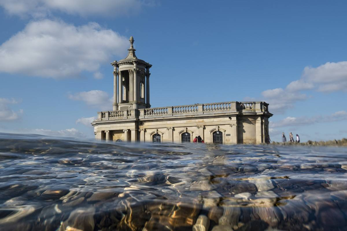 A view from water level shows Normanton Church in England.