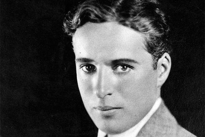 charlie chaplin in a black and white portrait