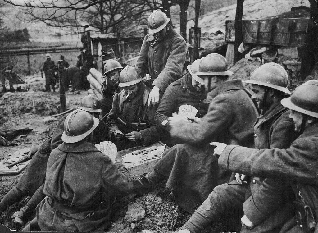 French soldiers playing cards to pass the time, on the Maginot Line during World War Two