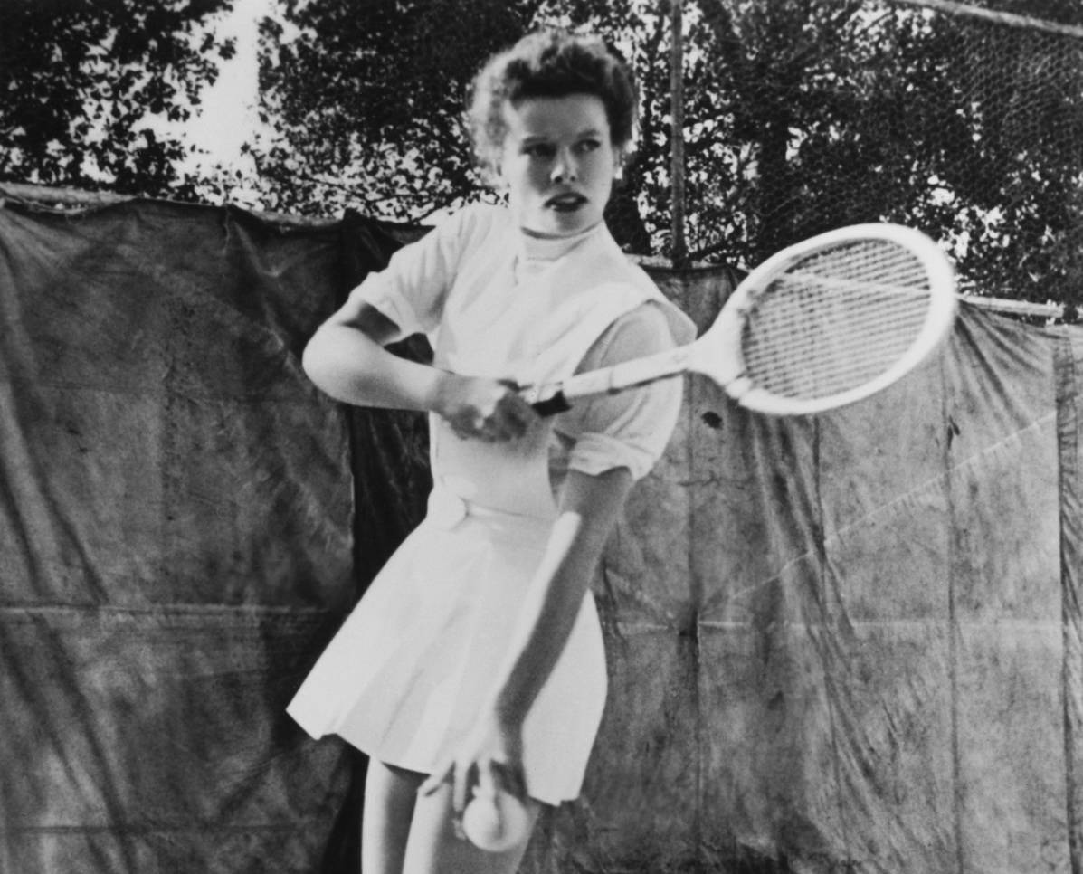Katharine Hepburn playing tennis.