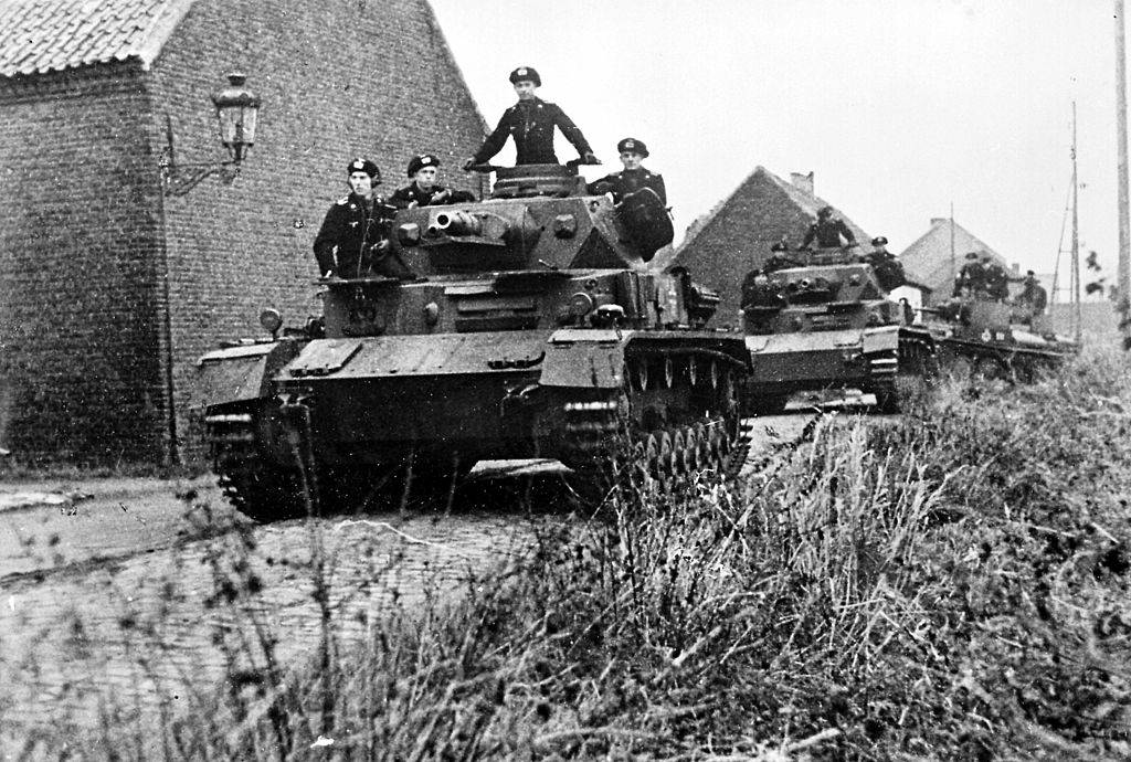 tanks being driven by soldiers during world war ii