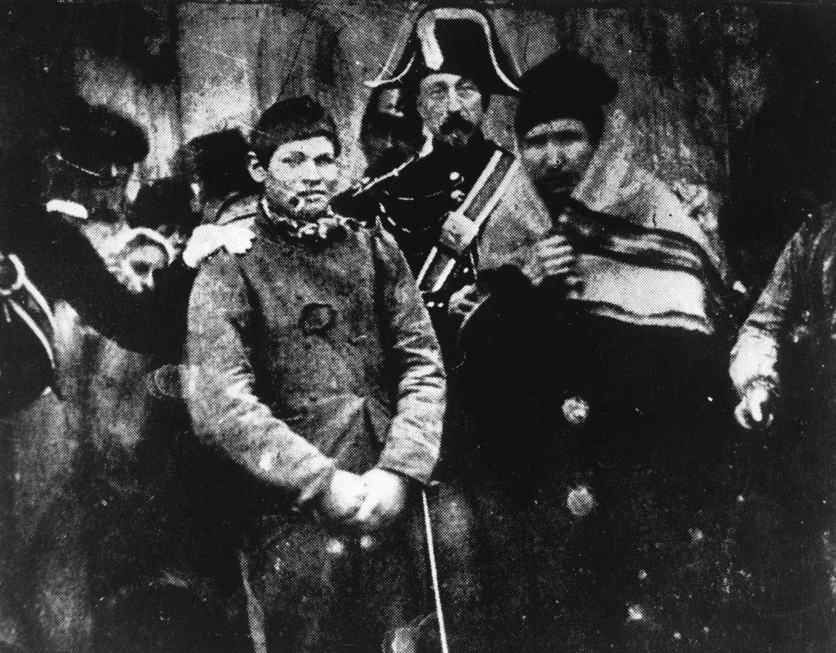 The first photo taken for the news shows a man being arrested in France.