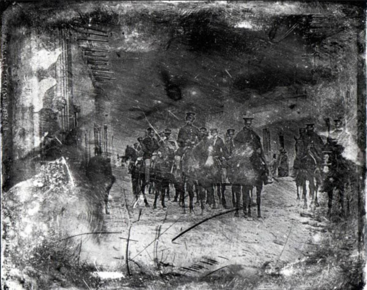 The first war photos show American soldiers on horseback.