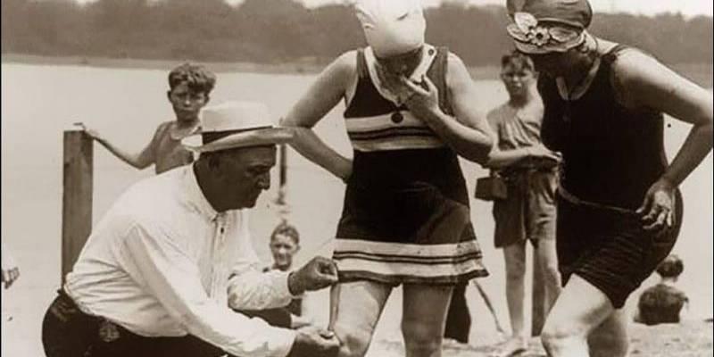 man checking bathing suit