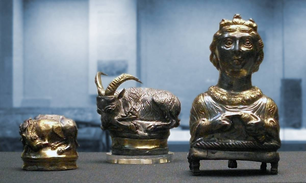 Three miniature sculptures from the Hoxne Hoard are displayed.