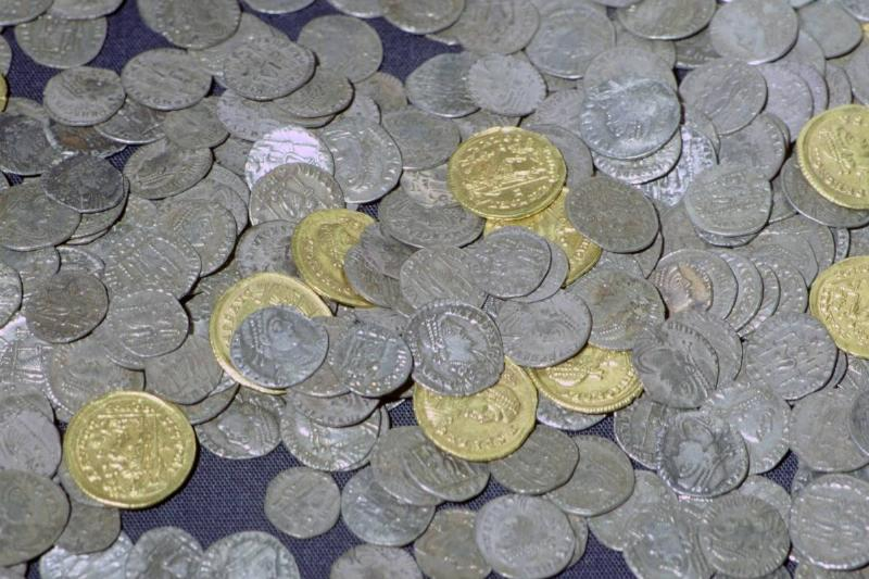Roman coins from the Hoxne Hoard are on display.