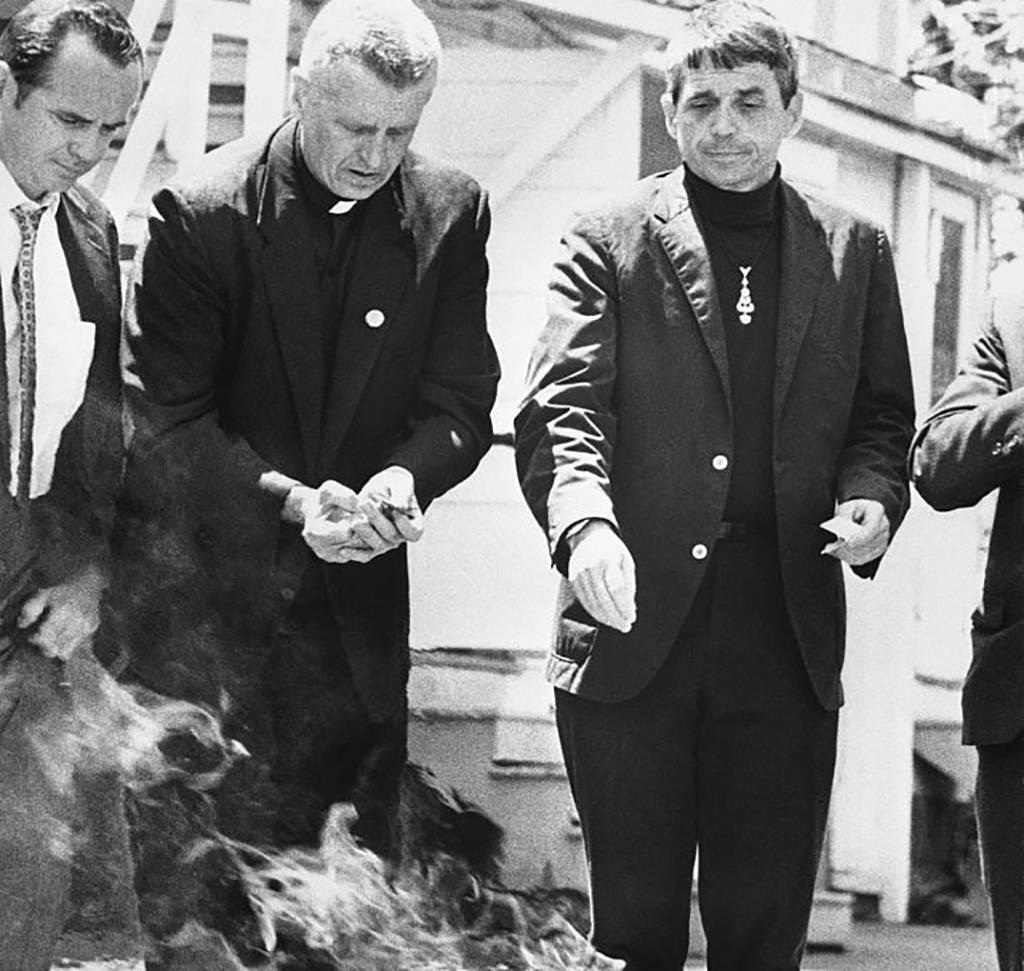 Priests burning draft cards