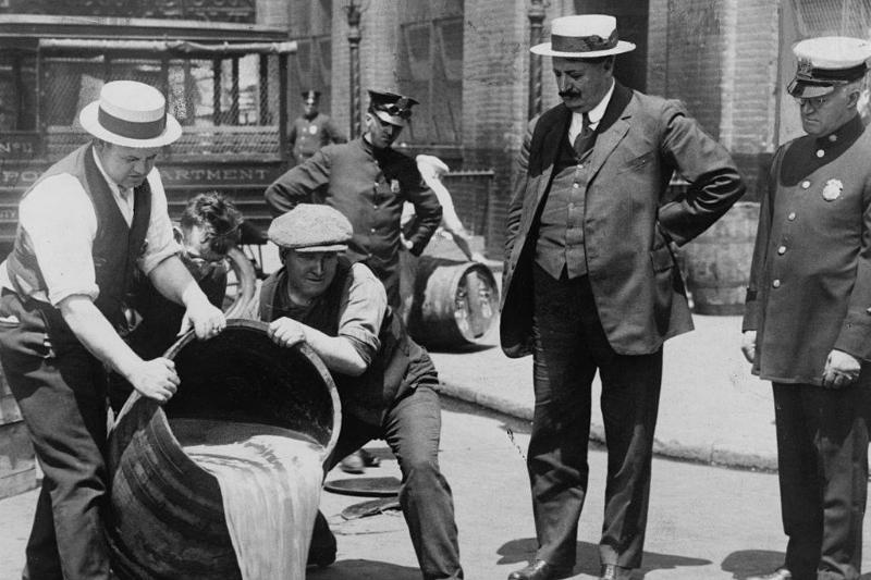 Men pouring out liquor