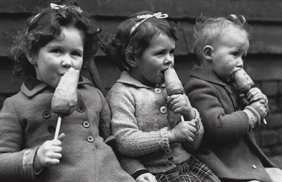 Children eating a carrot