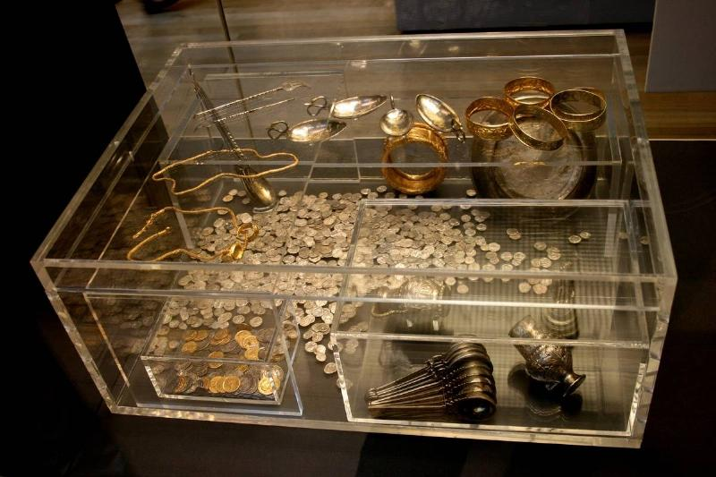 A glass display box shows findings from the Hoxne Hoard.