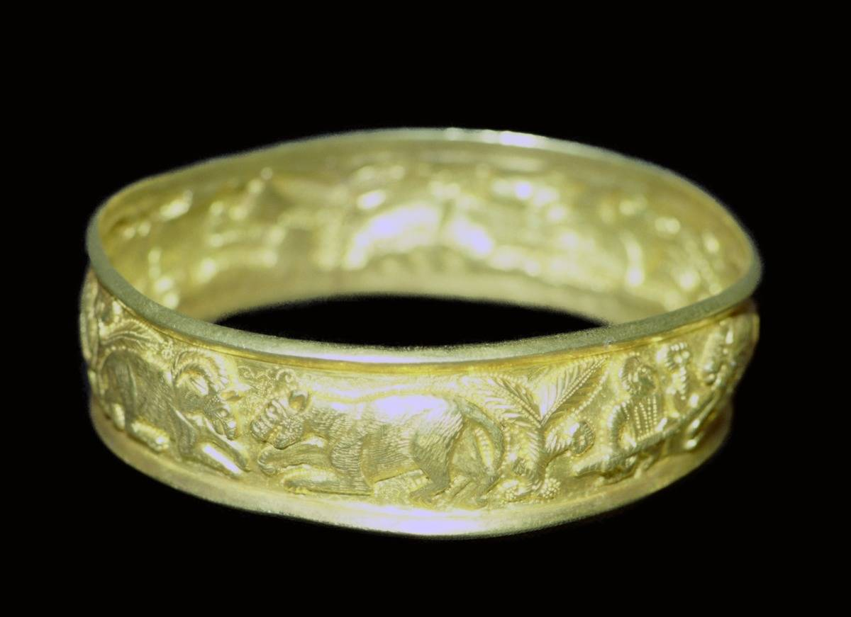 A golden bracelet from the Hoxne Hoard is on display.