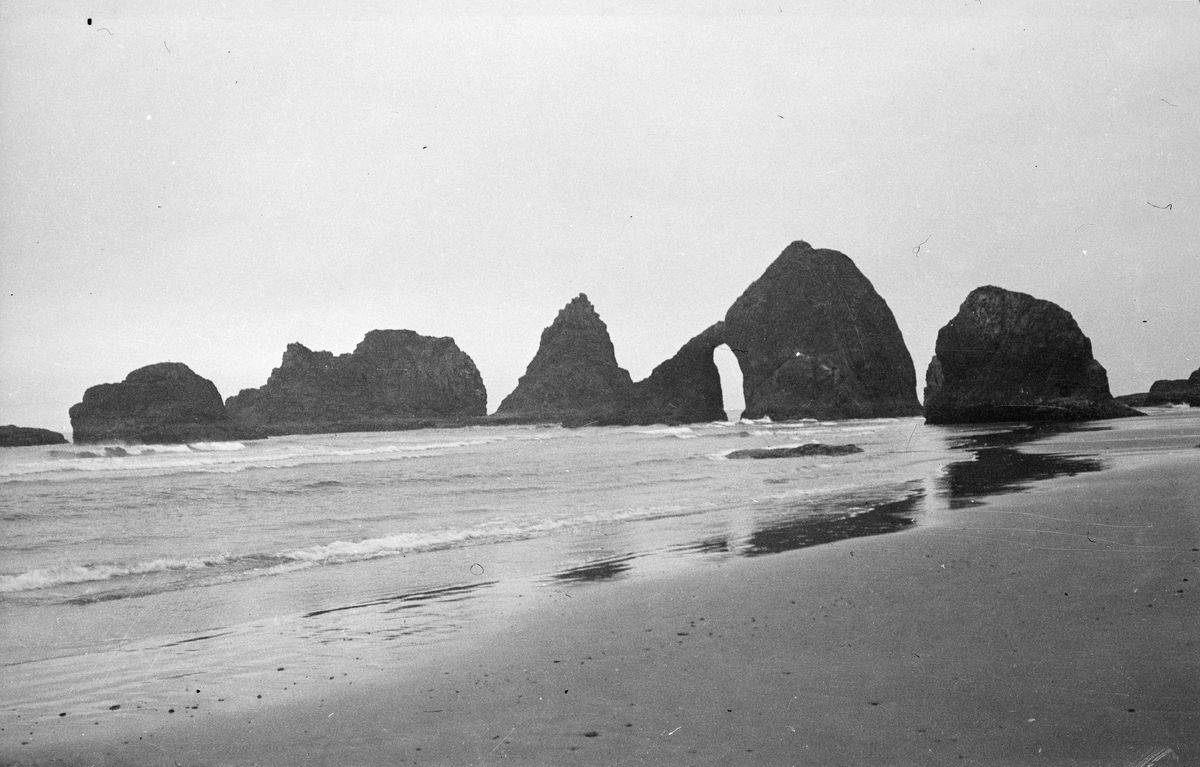 Rock formations are seen on a beach in this 1938 photograph.