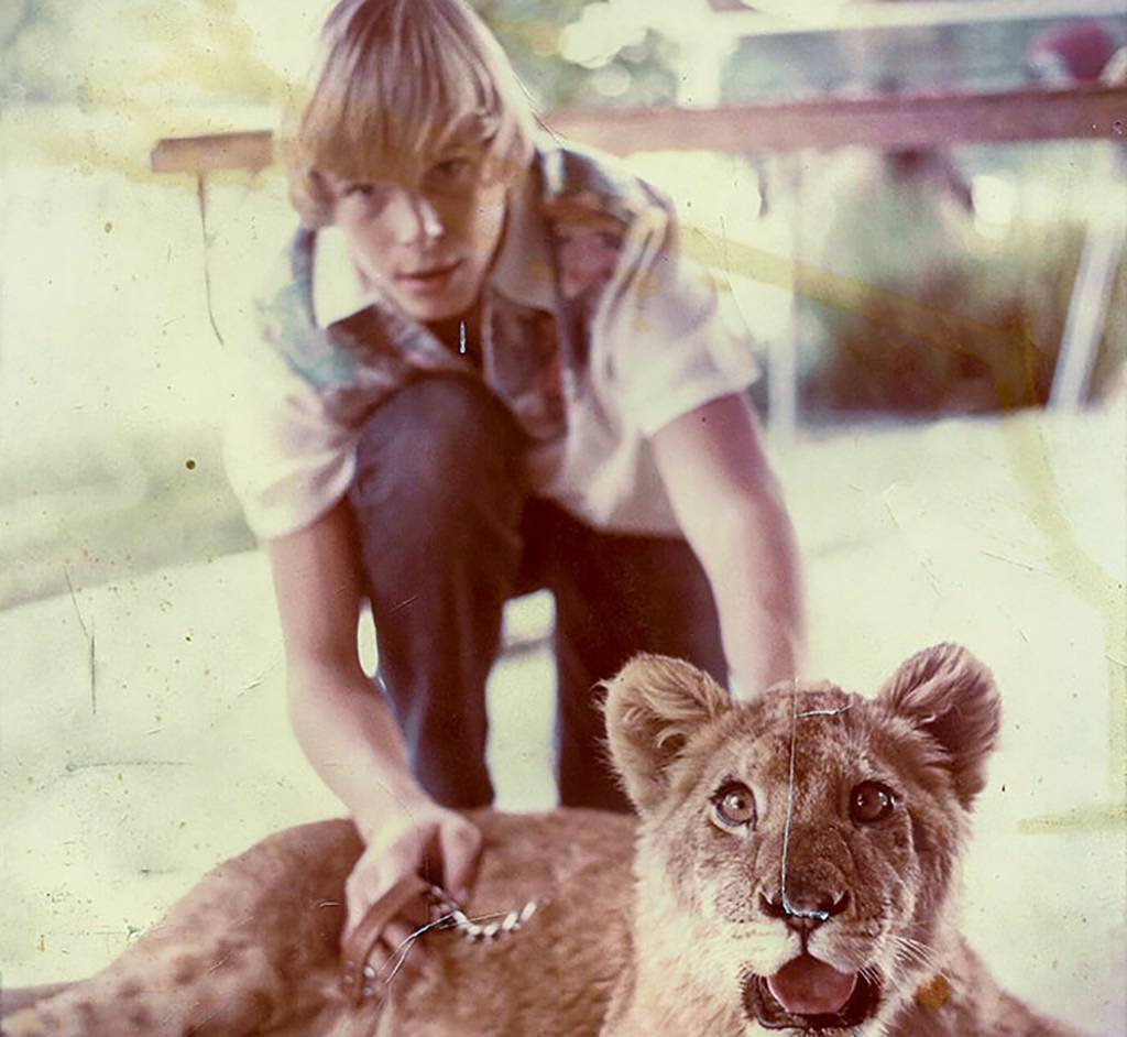 Picture of kid with lion