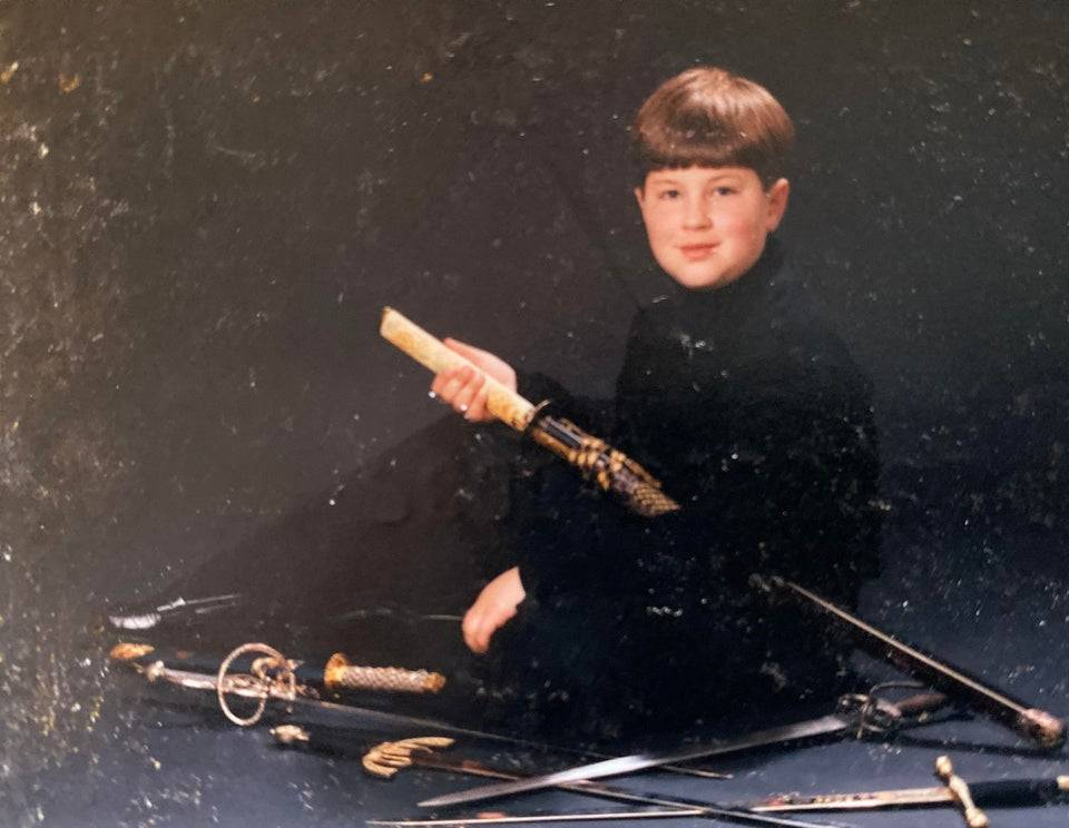 Kid with swords