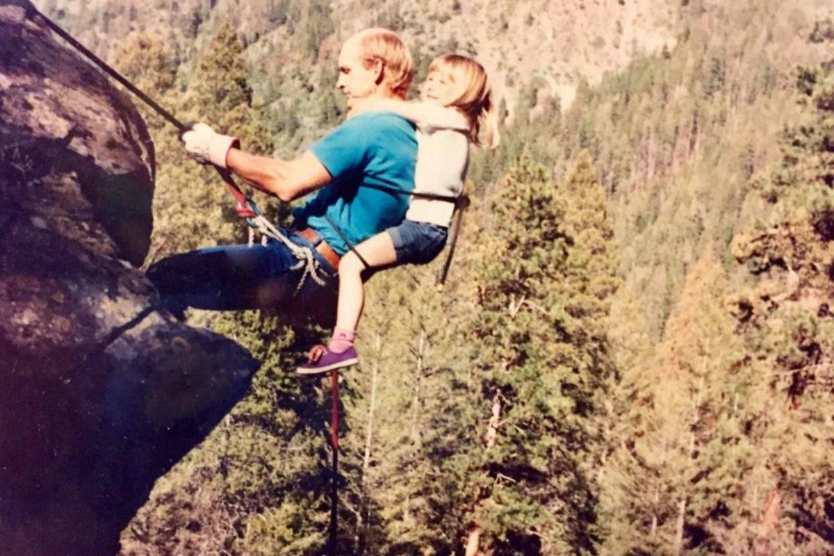 Girl and dad mountain climbing