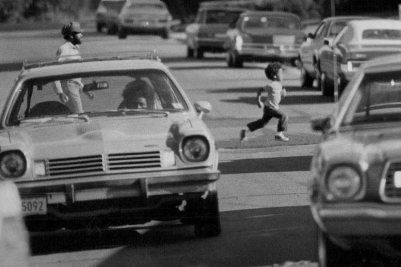 Kid running across the street