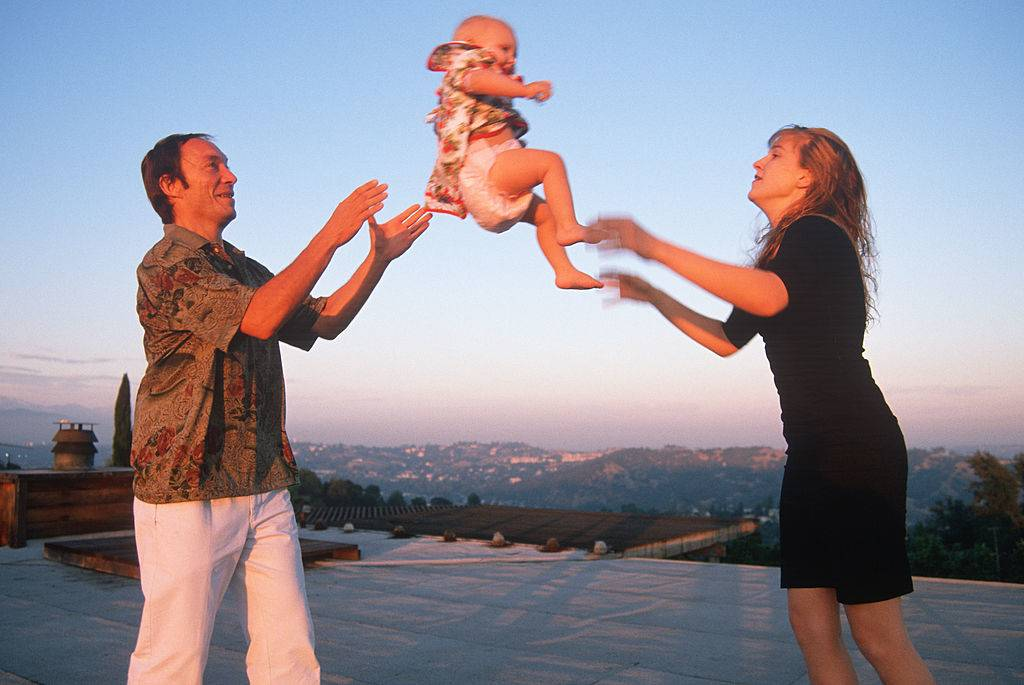 Picture of parents tossing child