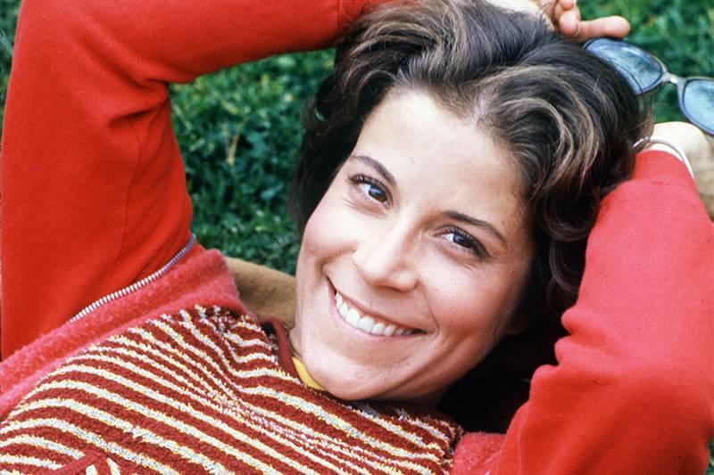 lani o'grady wearing a red striped shirt
