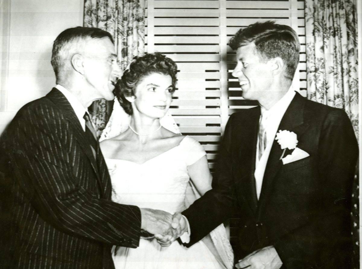 Senator Leverett Saltonstall congratulates Sen. John F. Kennedy at his wedding reception.