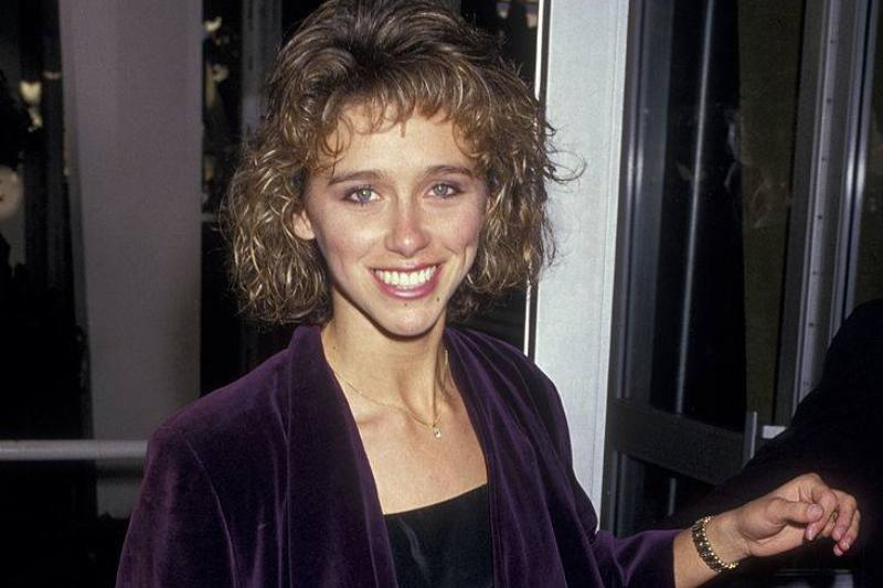 michele greene wearing a purple velvet outfit in the 80s