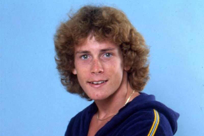 willie aames posing for a photo in the 80s