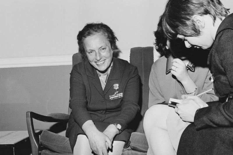 Red Army Soviet sniper Lyudmila Pavlichenko is seen sitting next to friends in 1968.