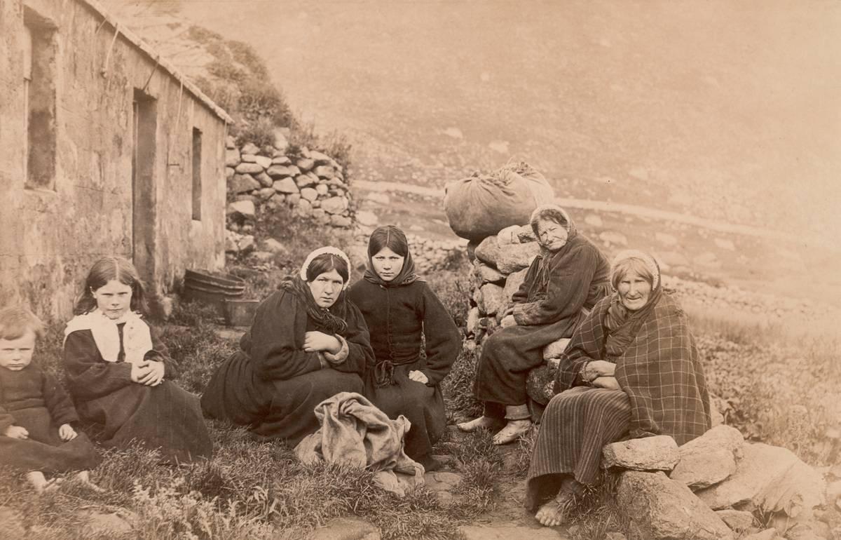 Three generations of women sit together on St Kildan, 1880.