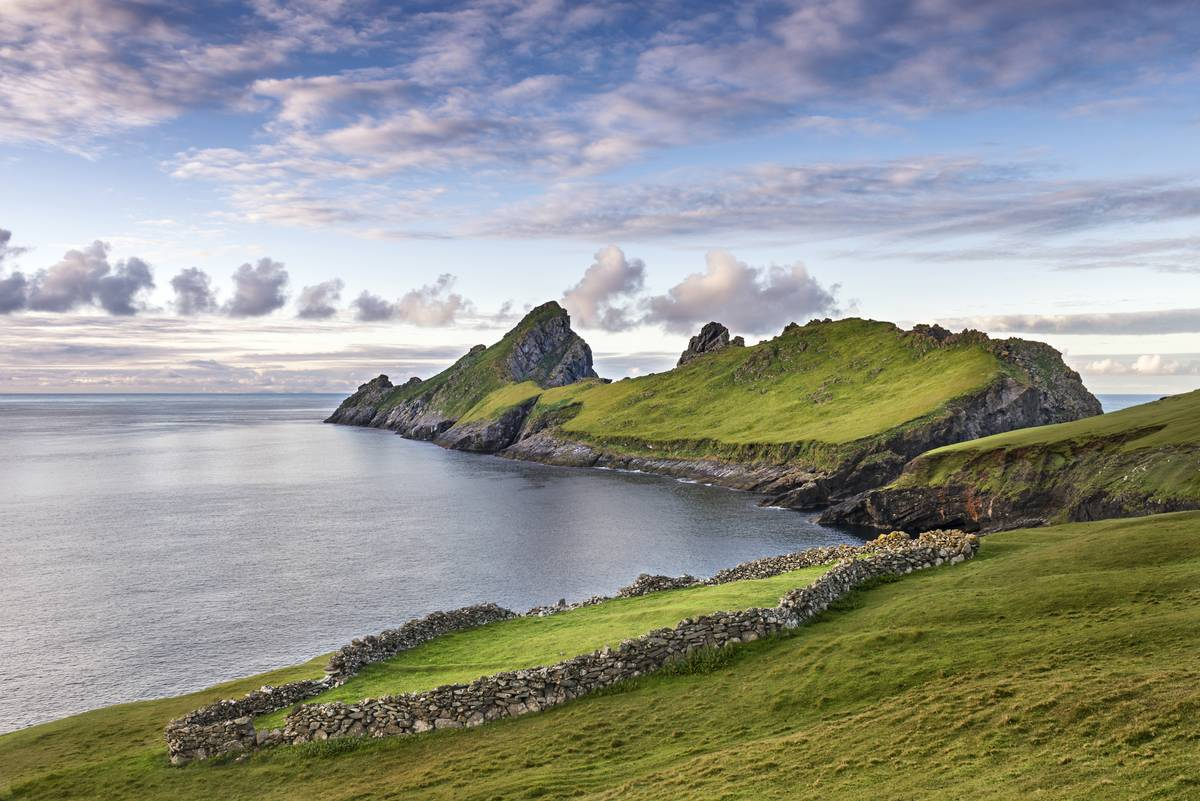 The island of Dun from St. Kilda is seen from a distance.