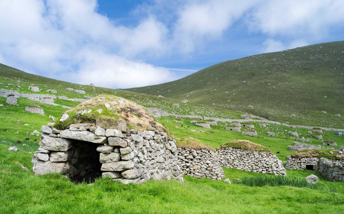 An ancient stone building is seen on the St Kilda.