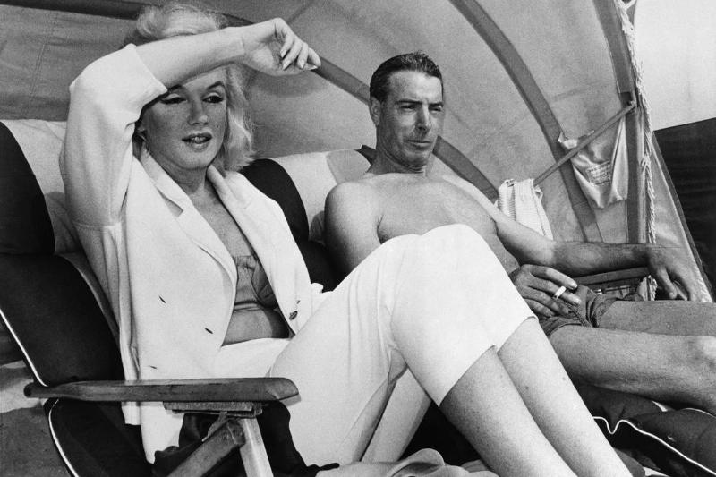 DiMaggio and Monroe Lounging on Beach in Florida