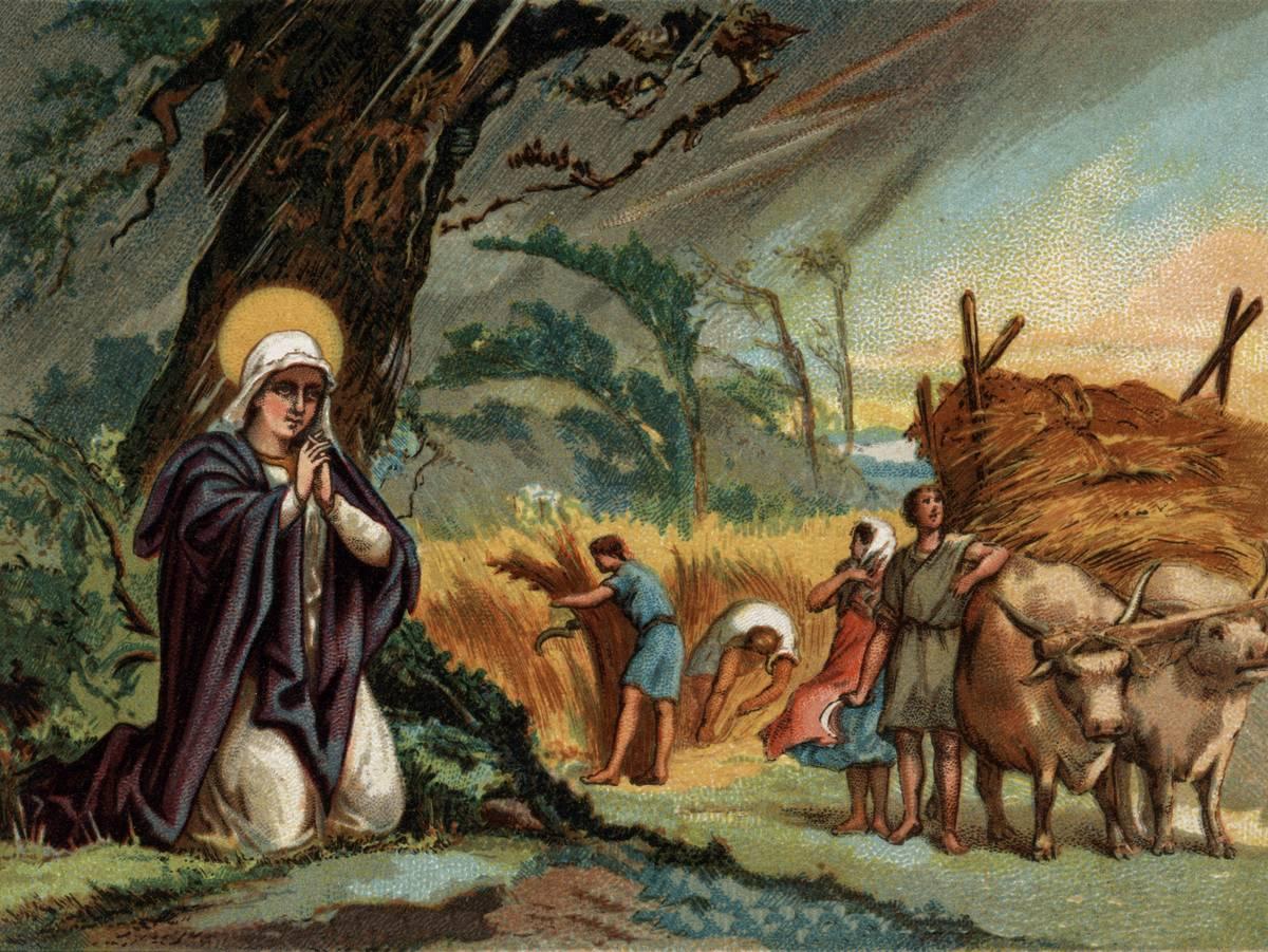 An illustration shows Saint Genevieve kneeling and praying.