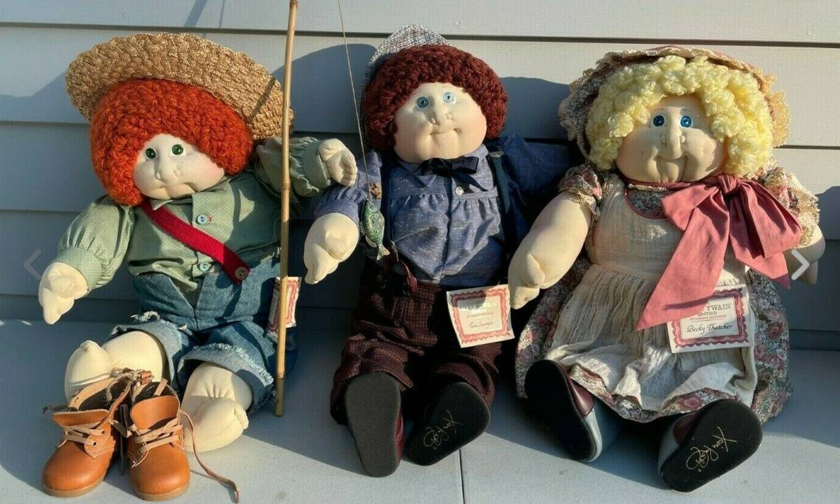 The Mark Twain Cabbage Patch Kids set includes doll versions of Tom Sawyer, Huckleberry Finn, and Becky Thatcher.