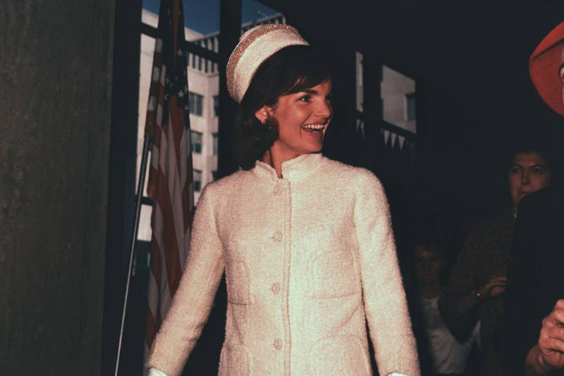 Jacqueline Kennedy Smiling While Attending Fashion Show