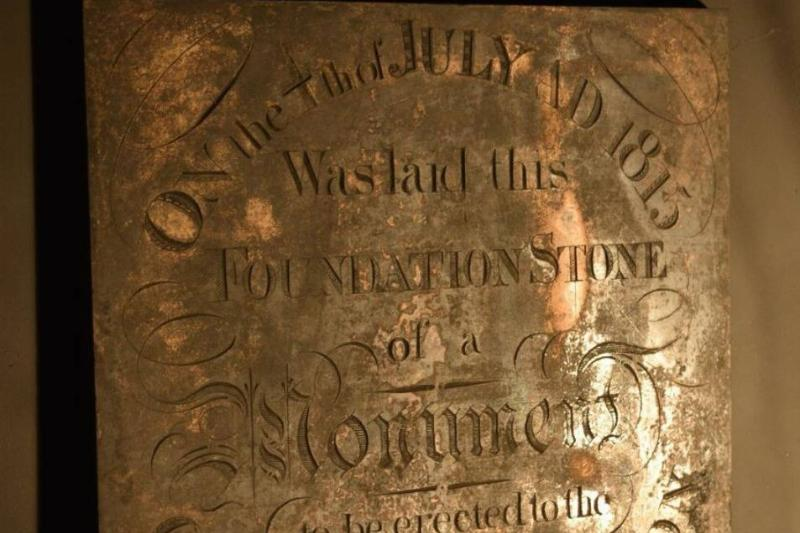 The copper plate with an engraving for the 1815 time capsule is cleaned and propped up.