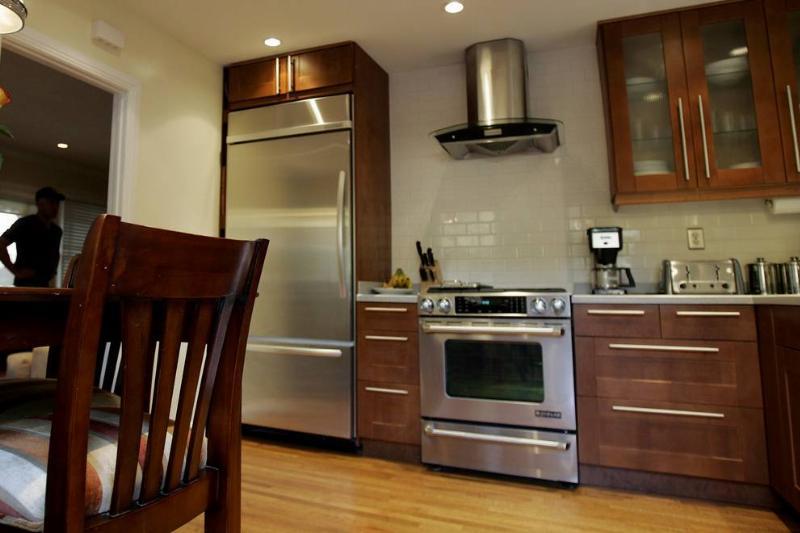 Alan Hopkins and his partner David McCoy kept the kitchens orginal footprint when remodeling_ addin