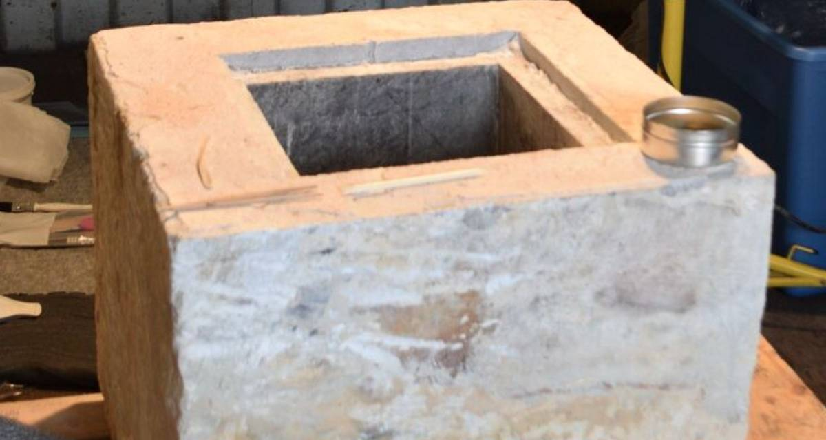 A concrete block has a square hold in it.