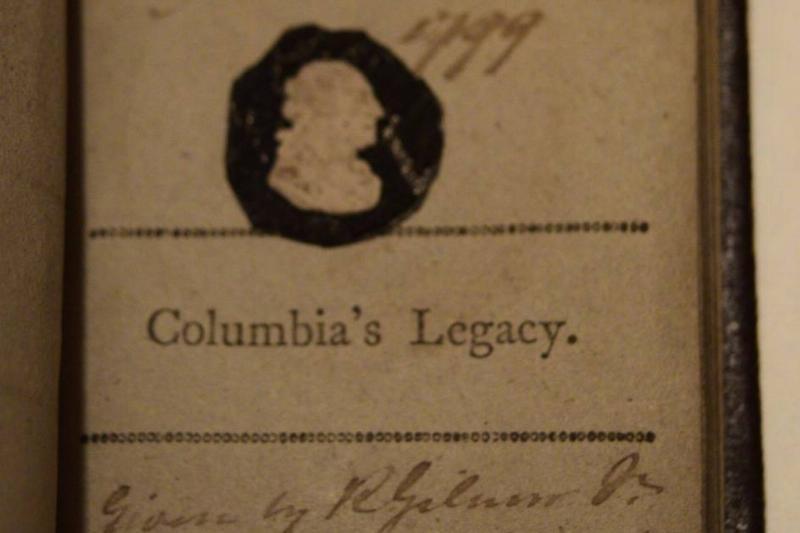 A close-up photo shows a copy of George Washington's farewell address.